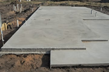Concrete slabs laid on the ground for foundation